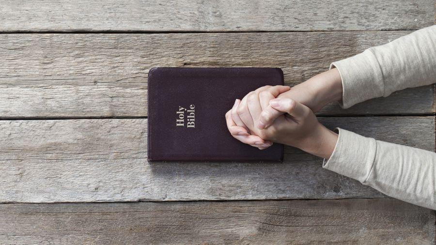 Bible-Wood-Hands-Prayer-Peace-900
